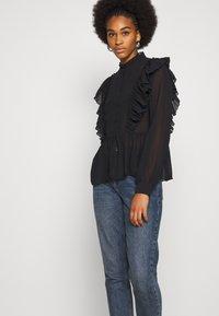 Vero Moda - VMIRIS FRILL  - Button-down blouse - black - 4