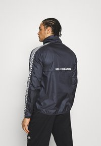 Helly Hansen - VECTOR PACKABLE ANORAK - Windbreaker - navy