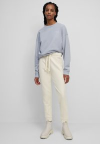 Marc O'Polo - Tracksuit bottoms - beige - 1
