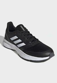 adidas Performance - NOVA FLOW SHOES - Zapatillas de running neutras - black - 3