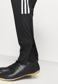 adidas Performance - TIRO - Tracksuit bottoms - black/white - 4