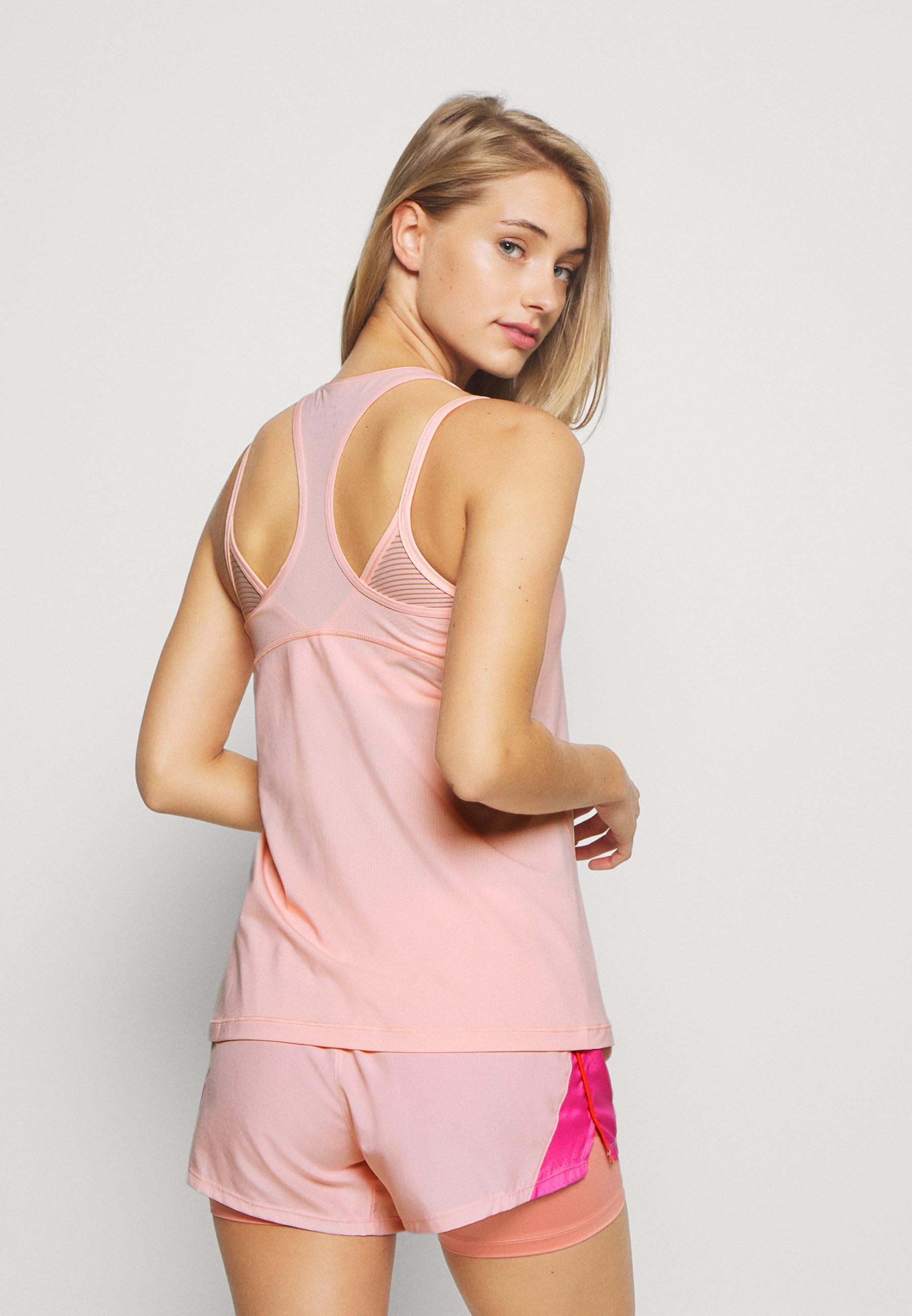 Nike Performance TANK ALL OVER  - Sports shirt - washed coral nd3cy