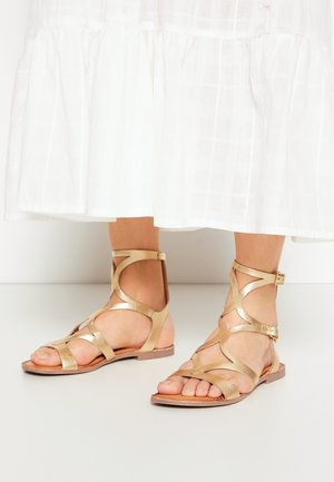 Ankle cuff sandals - oro