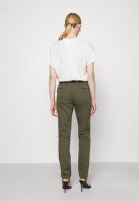 Vero Moda - VMFLASH BELT COLOR PANT - Trousers - ivy green - 2
