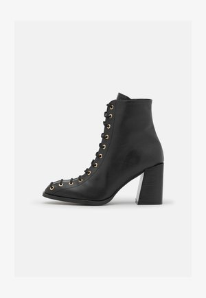 IRMA - Lace-up ankle boots - black