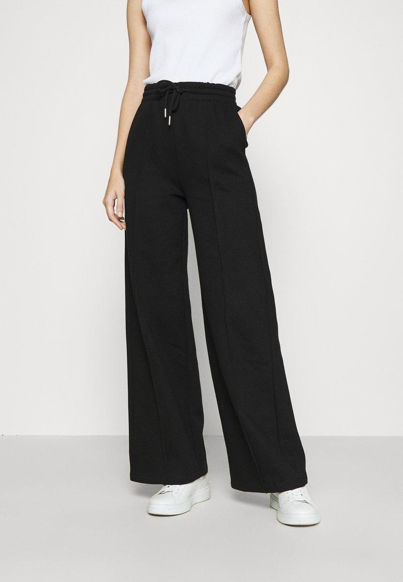 Gina Tricot - BONNIE - Teplákové kalhoty - black