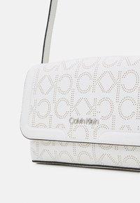 Calvin Klein - FLAP XBODY - Across body bag - white - 3