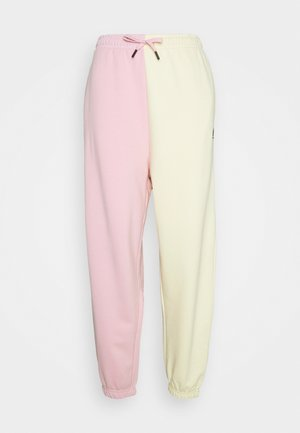 GEORGIA SLICED PANTS - Tracksuit bottoms - light pink/pale yellow