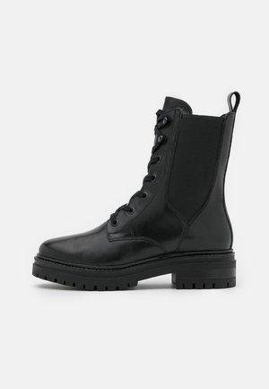 LEATHER - Plateaustøvletter - black