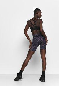 Nike Performance - ONE - Leggings - dark raisin/white - 2