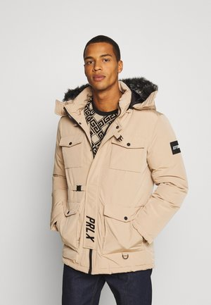 GALACTIC TECH JACKET - Winter coat - sand