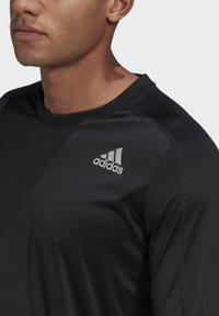 adidas Performance - OWN THE RUN LONG-SLEEVE TOP - Sports shirt - black - 3