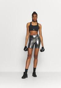 Nike Performance - AIR BRA - Medium support sports bra - black/reflective silver - 1