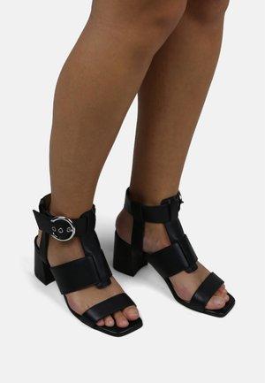 ECLIPSE GLADIATOR SANDAL - High heeled sandals - black