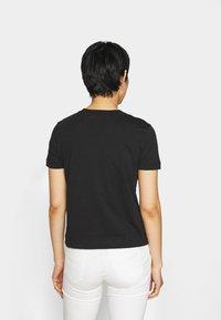 Calvin Klein Jeans - BONDED FILLED TEE - Camiseta estampada - black - 2