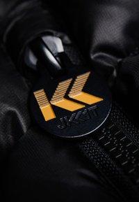 JACK1T - PRIME SLICK RACER - Doudoune - black/gold - 6