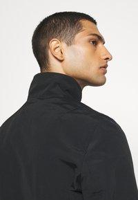 Calvin Klein - CASUAL BLOUSON JACKET - Summer jacket - black - 5