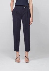 BOSS - TAPIA - Trousers - open blue - 0