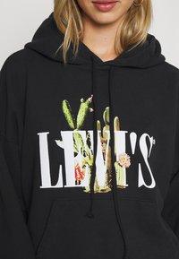 Levi's® - GRAPHIC 2020 HOODIE - Bluza z kapturem - caviar - 5