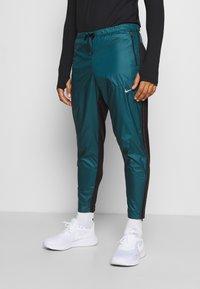 Nike Performance - SHIELD - Pantaloni sportivi - dark teal green/black/silver - 0