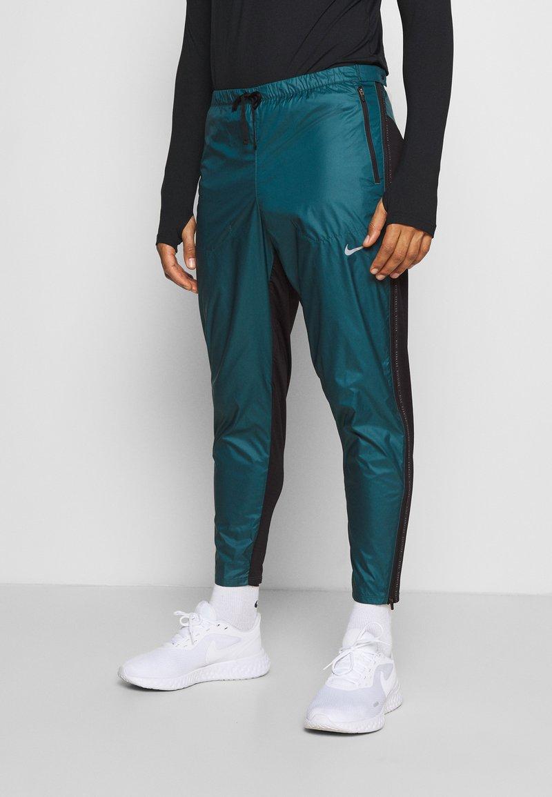 Nike Performance - SHIELD - Pantaloni sportivi - dark teal green/black/silver