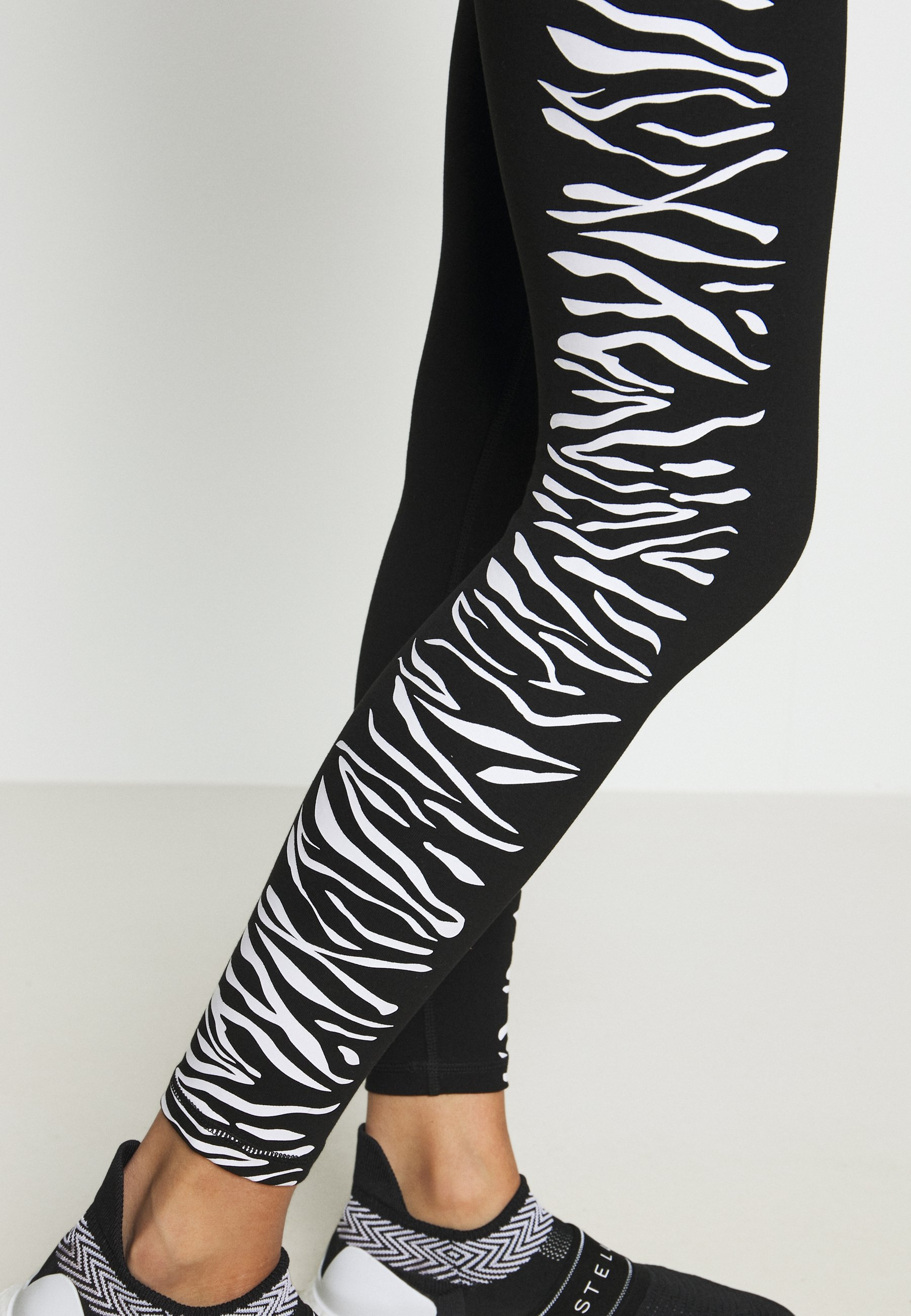 DKNY HIGH WAIST ZEBRA PLACED PRINT - Leggings - white mMODy