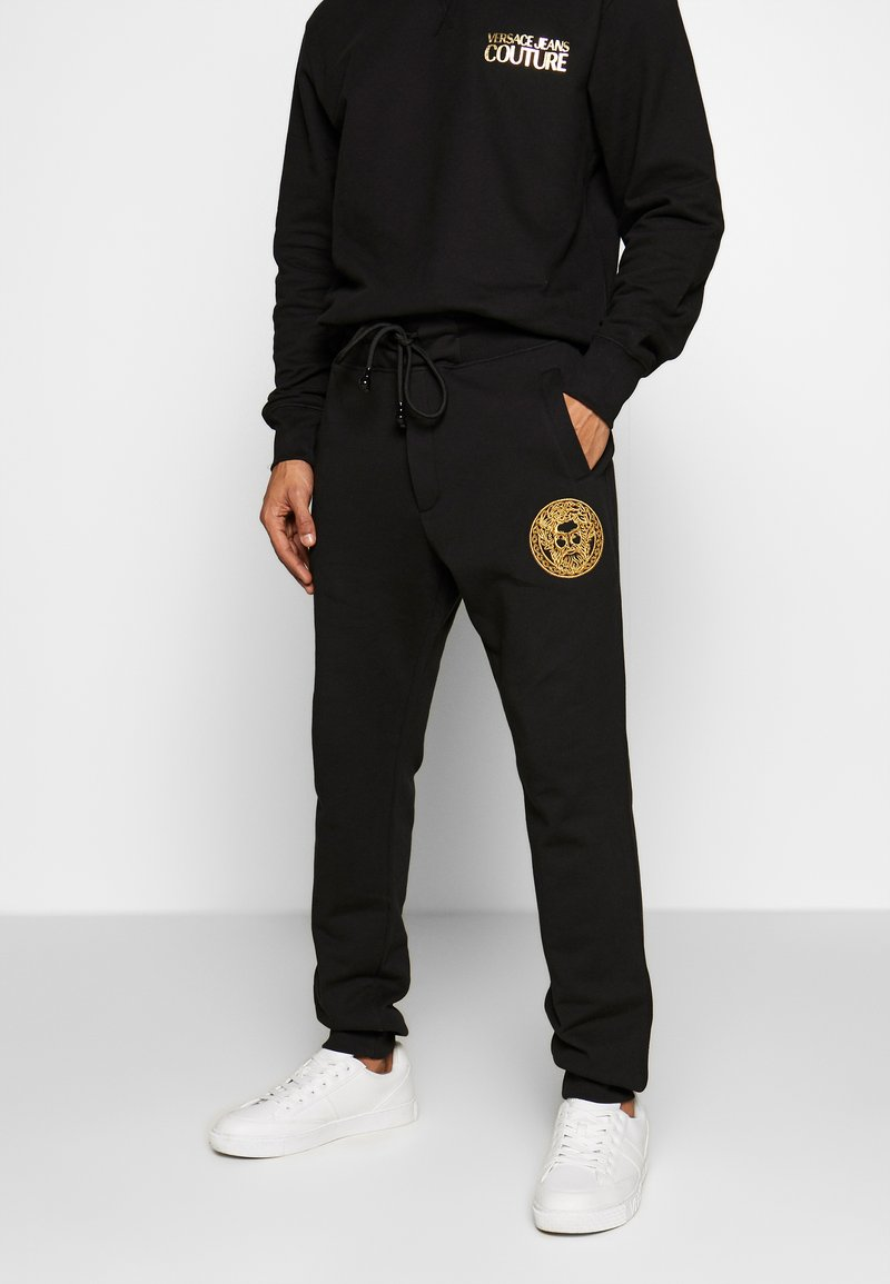 Versace Jeans Couture - PATCH JOGGERS - Verryttelyhousut - black