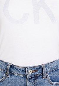 Calvin Klein Jeans - REVERSED LOGO MODERN SLIM TEE - Print T-shirt - bright white - 6
