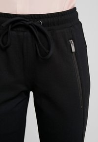 TOM TAILOR - ZIPPED PANTS - Tracksuit bottoms - deep black/grey - 6