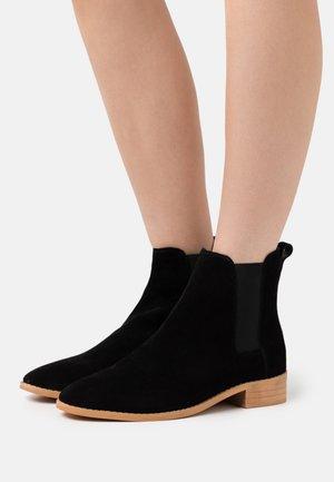 JUST BOOT - Kotníkové boty - black