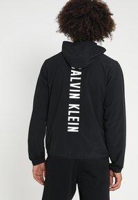 Calvin Klein Performance - JACKET - Windbreaker - black - 2