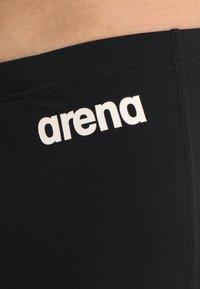 Arena - SOLID JAMMER - Swimming trunks - black/white - 2