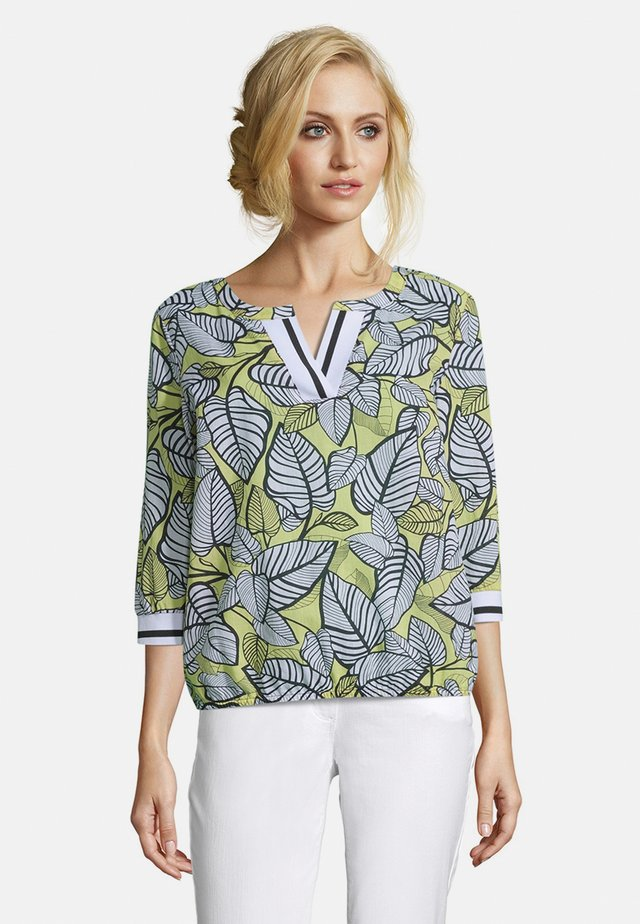 MIT BLUMENPRINT - Blouse - yellow/black