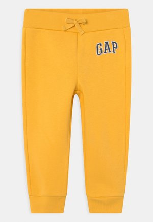LOGO - Trousers - pale gold