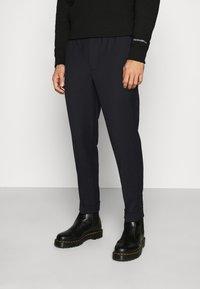 Calvin Klein Jeans - GALFOS - Spodnie materiałowe - black - 0