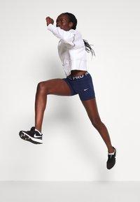 Nike Performance - DRY GET FIT - Sweatshirt - white/black - 3