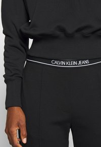 Calvin Klein Jeans - LOGO ELASTIC MILANO TROUSER - Trousers - ck black - 5