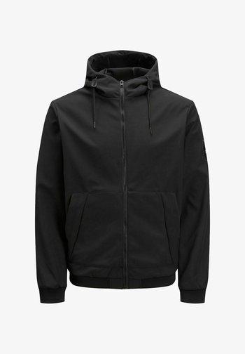 ÜBERGANGS - Light jacket - black