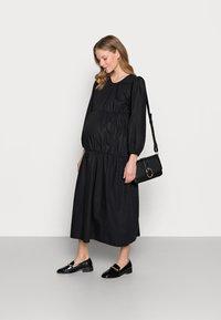 Topshop Maternity - SMOCK TIERED DRESS - Day dress - black - 1