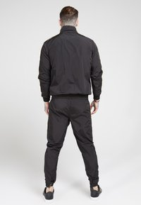 SIKSILK - QUARTER ZIP FUNNEL TAPE OVERHEAD - Summer jacket - black/gold - 2