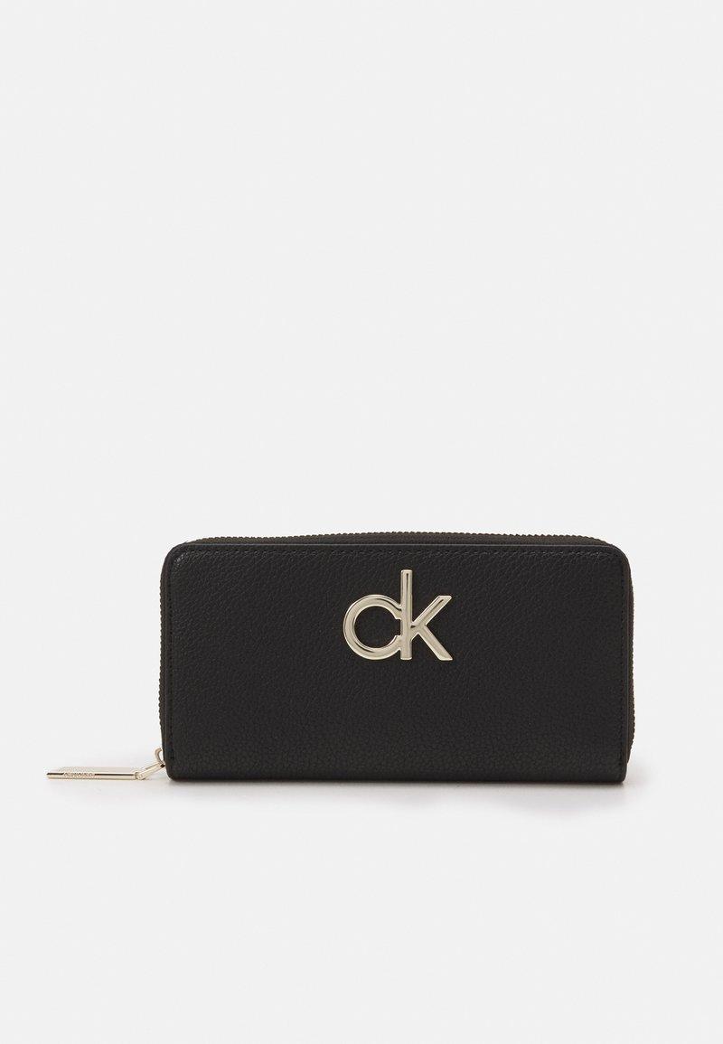 Calvin Klein - RE LOCK ZIPAROUND - Wallet - black