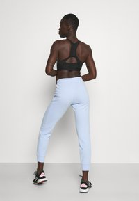 Calvin Klein Performance - PANTS - Tracksuit bottoms - sweet blue - 2