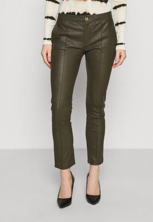 DOGUNA - Leather trousers - deep