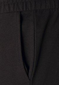 Zign - Tracksuit bottoms - black - 6