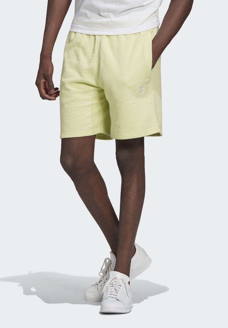adidas Originals - ESSENTIAL UNISEX - Shorts - yellow tint