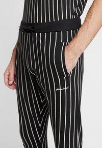 Nominal - GHAZNI - Teplákové kalhoty - black - 5