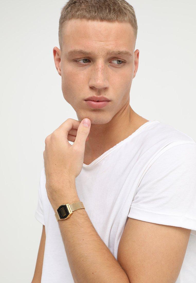 Casio - Digitální hodinky - goldfarben/schwarz