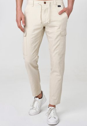 CAGLE - Cargo trousers - off-white