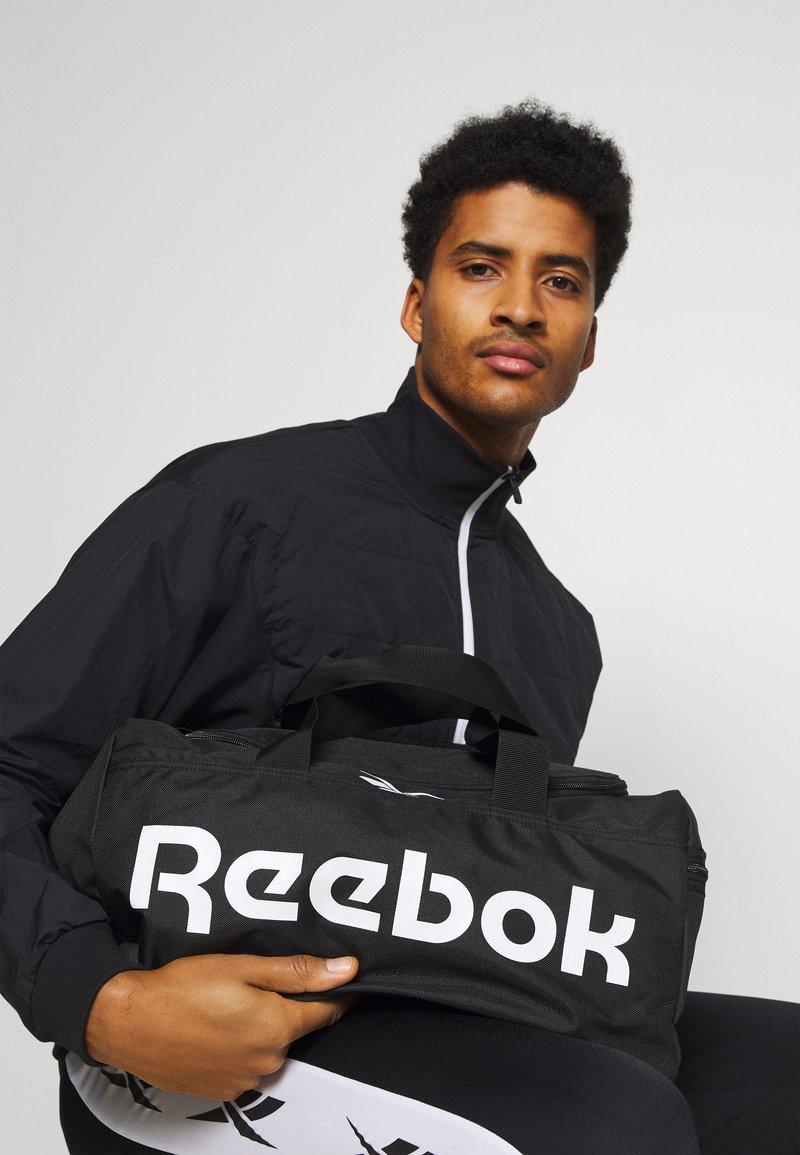 Reebok - ACT CORE GRIP UNISEX - Sportväska - black/white
