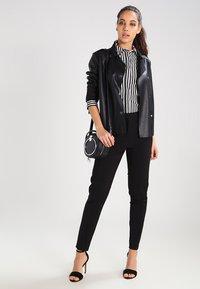 Vero Moda - VMVICTORIA - Spodnie materiałowe - black - 2
